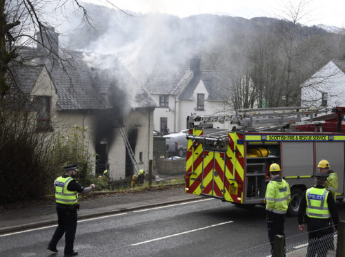 Firefighters at the scene of the fire in Invergarry. Picture by Iain Ferguson.