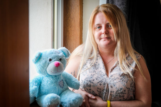 Laura Gallazzi with Steven's teddy bear, which now contains his ashes.