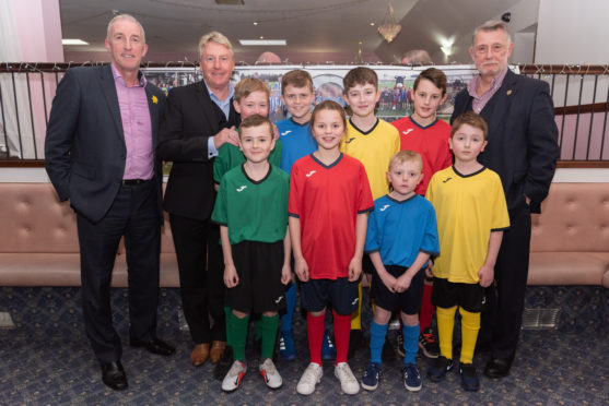 The money used will help the group buy new equipment and football strips. Pictured, with guest speakers Frank McAvennie and Donald Findlay: Lucy Mark, Ben Fettes, Lewie Mckenzie, Ryan Garden, Logan Mckenzie, Sonny Dalgarno, Jake Taylor, Finn Davidson.