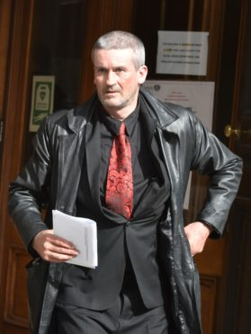 Kevin Robertson leaves Aberdeen Sheriff Court.