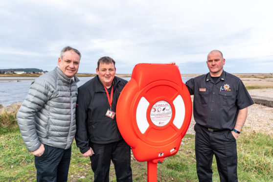 New lifesaving rings are installed at the mouth of the River Spey at Spey Bay following a joint project by fire station in Fochabers and Coastguard. (L-R) MSP Richard Lochhead, firefighter Sid Whyte and crew manager Dave Crawford of Fochabers Fire Station.