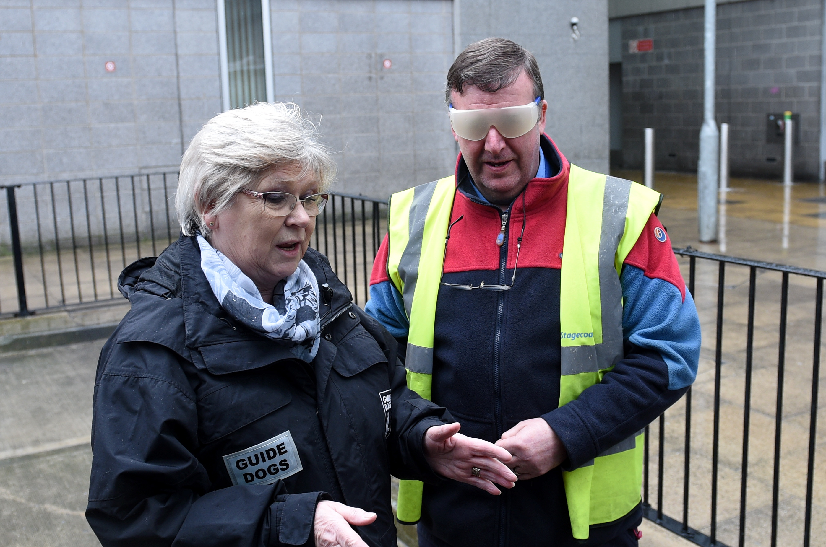 Pamela Munro, engagement officer for Guide Dogs Scotland, and Keith Boyd, Stagecoach bus driver, take part in training sessions at Aberdeen Bus Station.