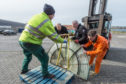 Picture by JASON HEDGES      Pictures document the arrival of a new lighthouse lens delivered to the Lighthouse museum in Fraserburgh, Aberdeenshire today.  Picture: Lenses arfe man handled onto the crate  Pictures Jason Hedges