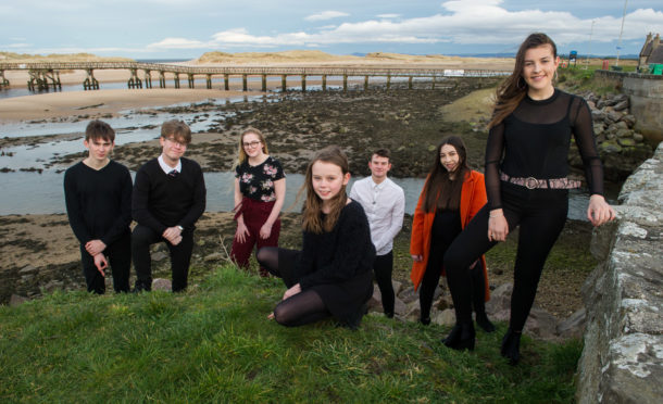 Music group Bel Canto and Friends are pictured by Lossiemouth footbridge over to East Beach.