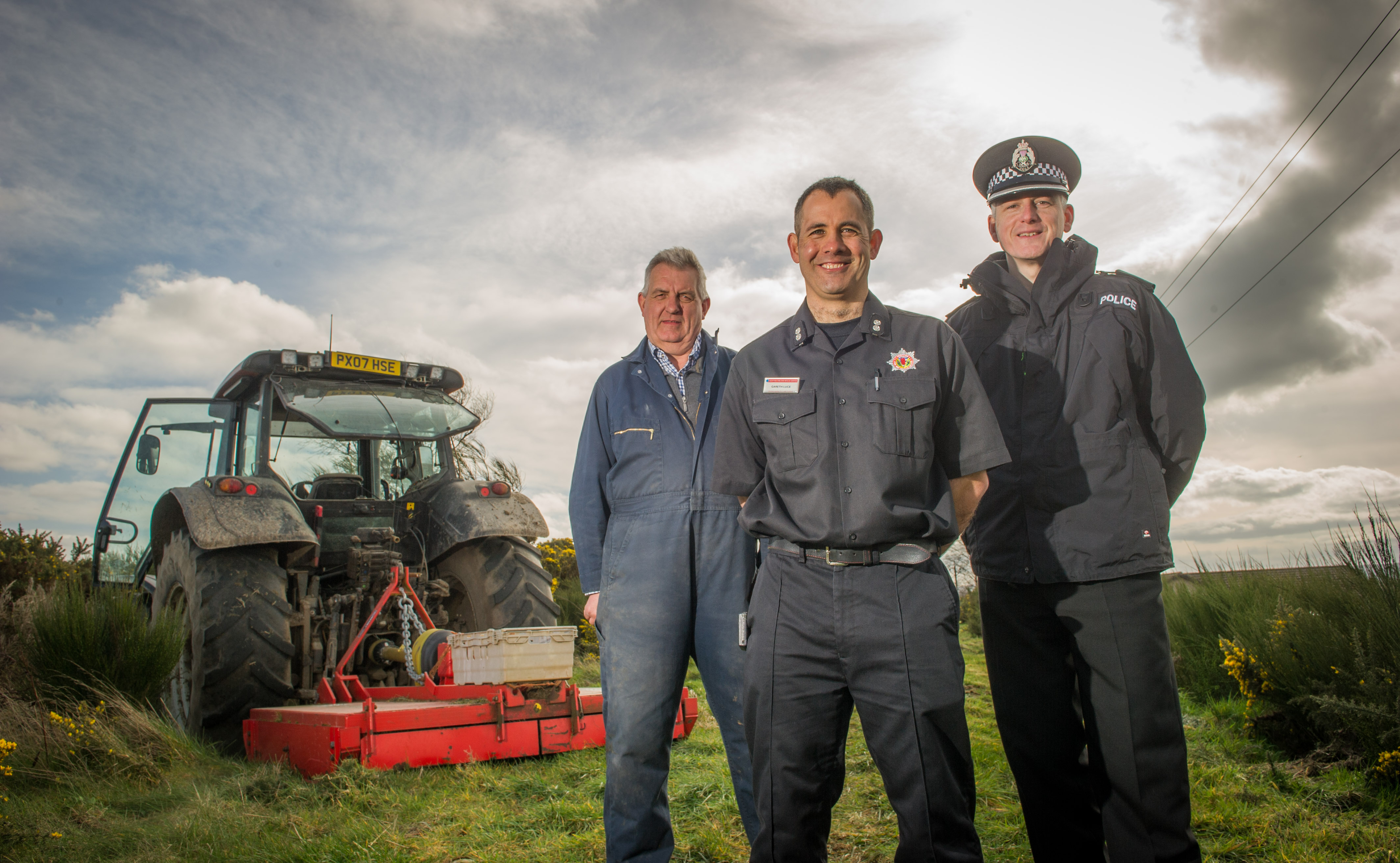 L-R: Pitgaveny Farms manager Martin Birse, Inspector Norman Stevenson, Watch Manager Gareth Luce.