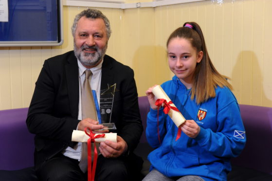 Martin Kasprowicz and Shannah Findlay with their awards.
