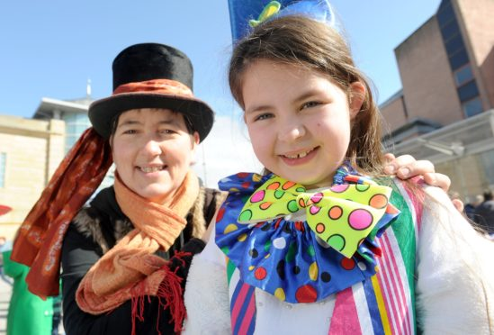 'Clown' Masie Meechan (8) of Tain is helped by Karen Grant of Flyagaric Performing Arts of Forres.