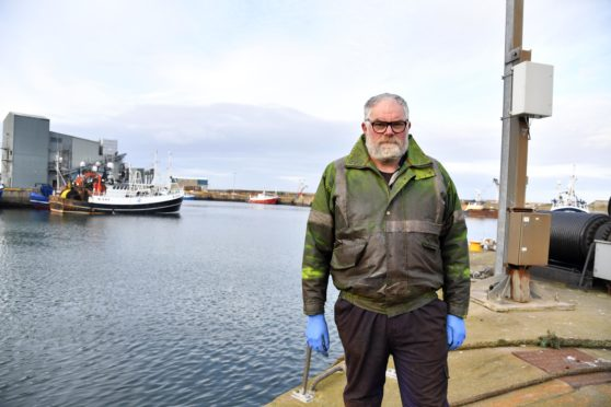 Mechanic Mark Reason is worried about the amount of oil slicks in Fraserburgh harbour.