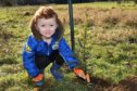 ALFIE MCDONALD (4) FROM PETERHEAD ENJOYING THE TREE PLANTING AT ADEN COUNTRY PARK.