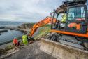 Work has begun to prevent landslips in Portknockie.
