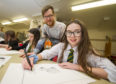 National Galleries of Scotland outreach officer Richie Cumming  works with Milne's High School S1 pupil Anna Russell.