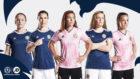 Aberdeen's Rachel Corsie (centre) models the new Scotland women's away kit, while Kim Little (far left) from Mintlaw wears the new home shirt.