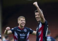 Ross County striker Brian Graham celebrates the win over Partick Thistle with Jamie Lindsay.