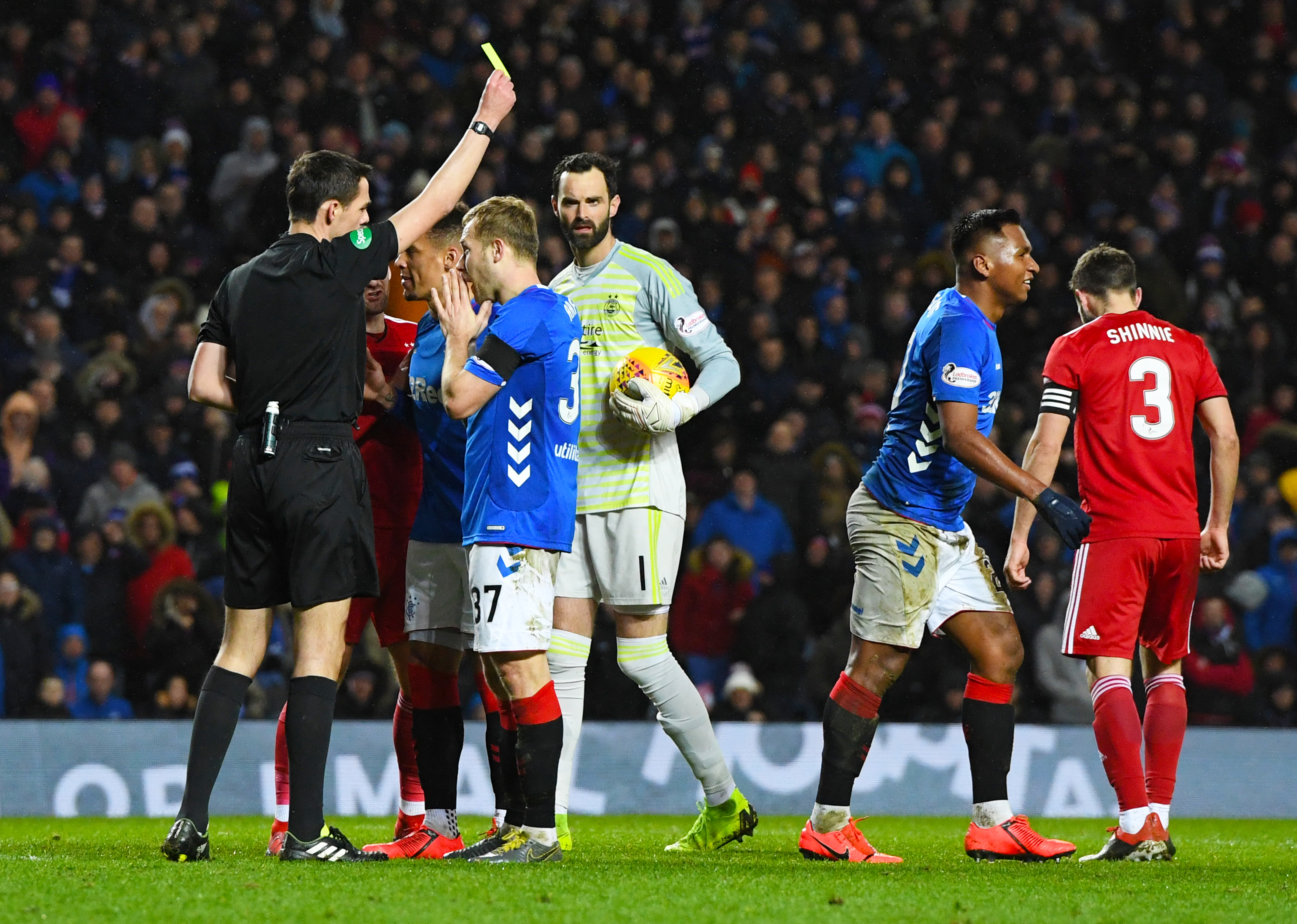 Alfredo Morelos is booked against Aberdeen.
