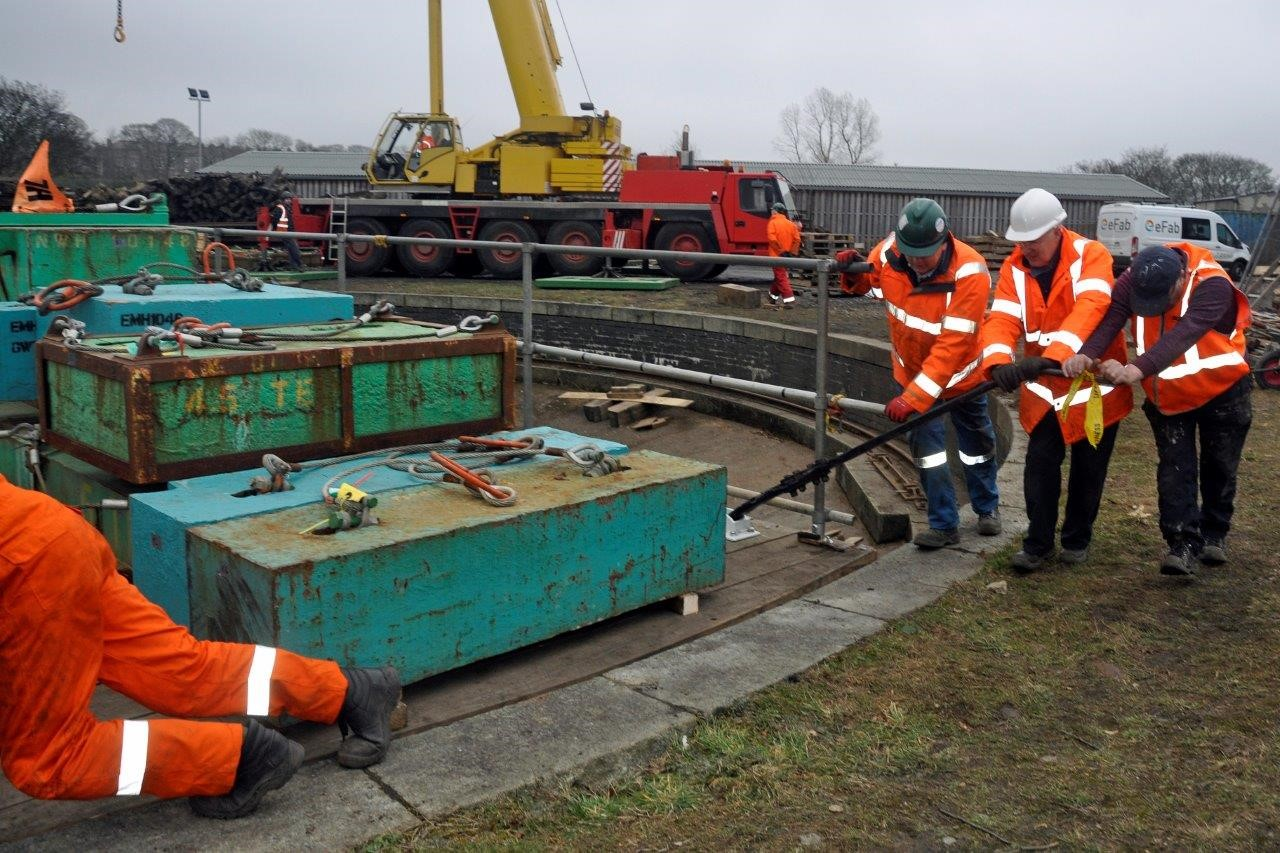 Volunteers carry out a test rotation of the turntable