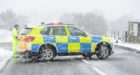 Police at the scene of the crash. Picture by Colin Rennie.