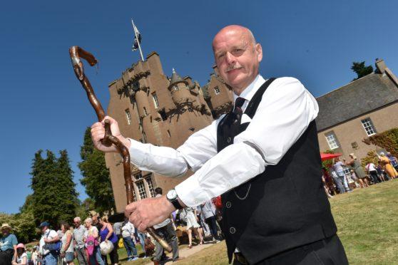 Graham Guyan with Harry Lauder's walking stick.