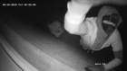 One of the raiders caught in frame smashing the CCTV camera.