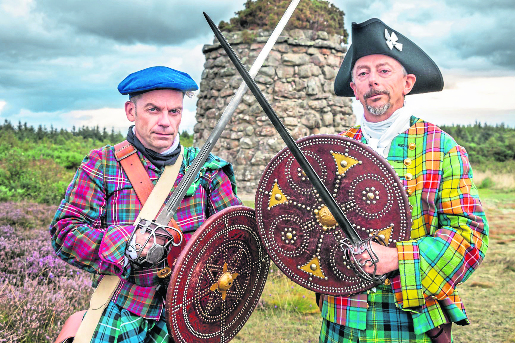 Men dressed as Jacobite warriors at Culloden.