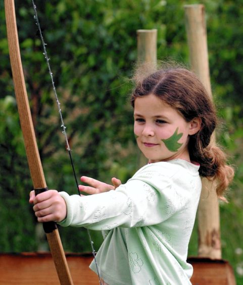 Ailsa Durden 8 from Queenscross tries her hand at archery.