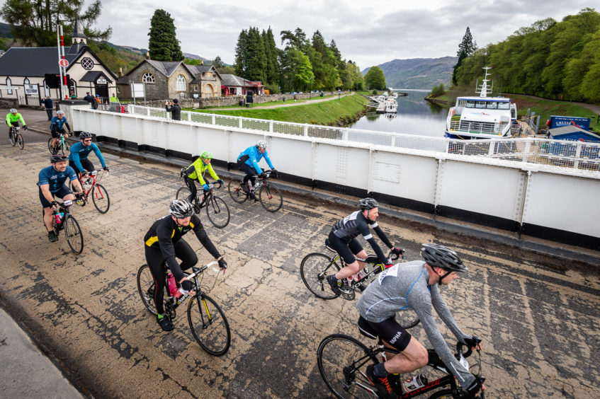 Riders cross the canal in Fort Augustus before taking the big hill of the route.