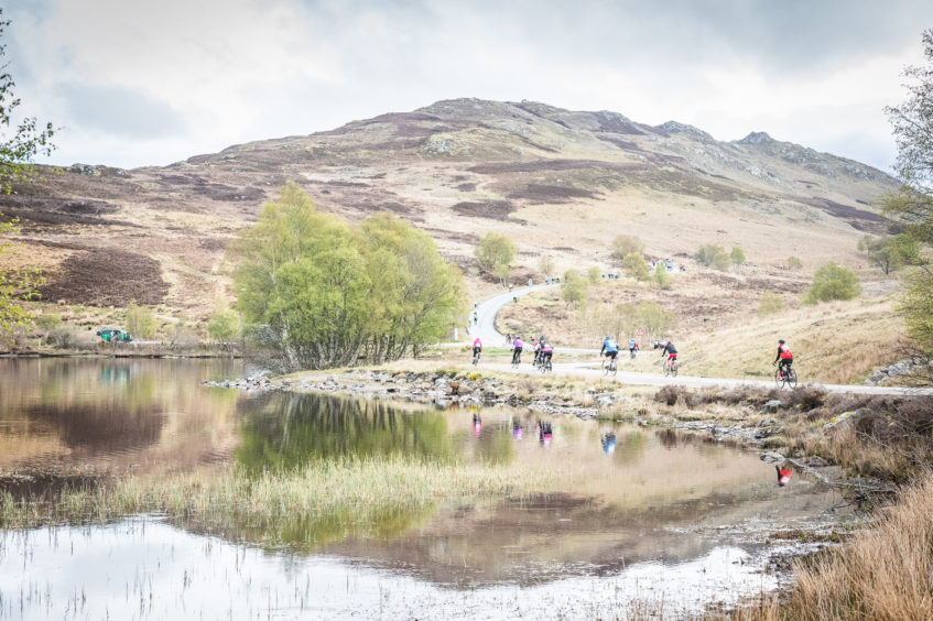 Cyclists enjoy the welcome break of Loch Tarff before hitting the climb again to the Suidhe viewpoint..