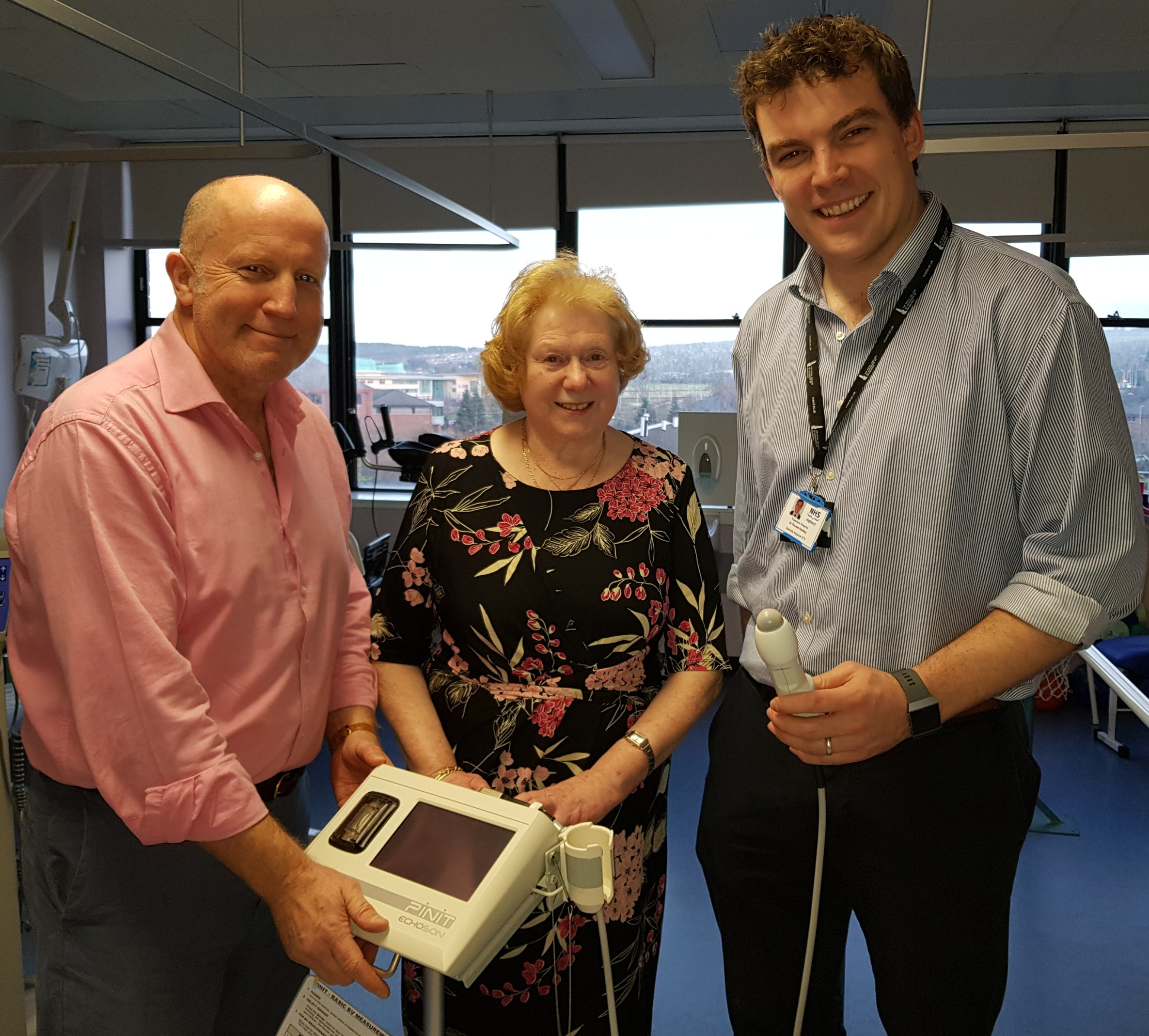 Mr Andrew Kent, consultant orthopaedic surgeon with Christina Cameron, chair of the Friends of Raigmore and Dr Thomas Harding, specialty registrar with the bladder scanner.