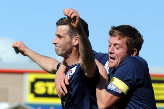 Stuart Kettlewell and Richard Brittain, both now on the coaching staff at Ross County, celebrate against Hamilton Accies in 2012.