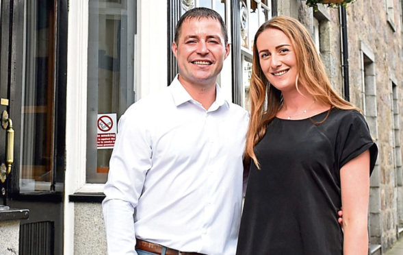 Pictured are Paul and Emma Beattie, the new owners of The Globe Inn, North Silver Street, Aberdeen.