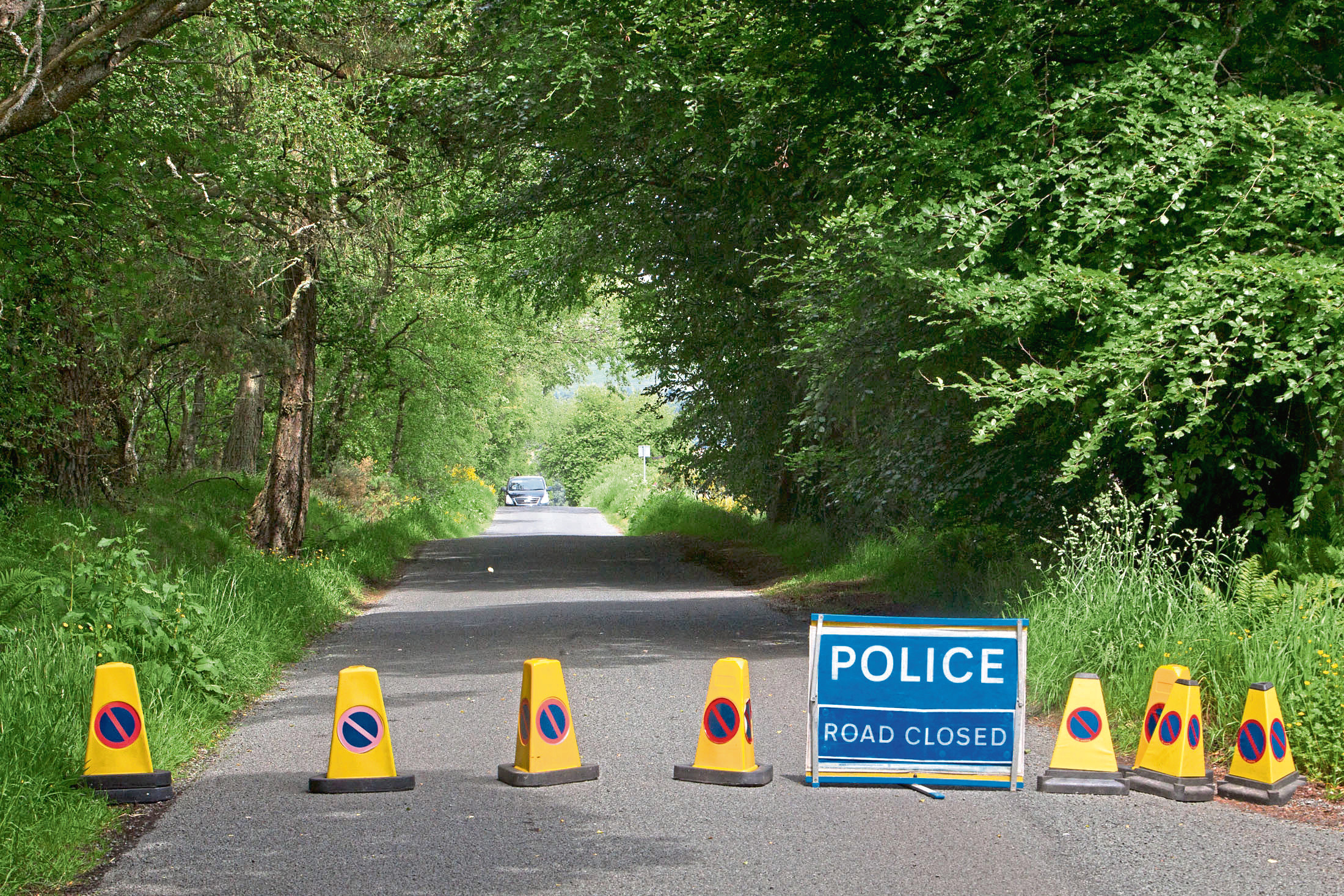 Kinnordy nature Reserve Murder.....police attend two locations....17 Hill Rise in Kirriemuir and Egnanoss Road behind Westmuir....various locations..  Pic shows police roadblock at Egnanoss Road behind Westmuir..pic :Paul Reid