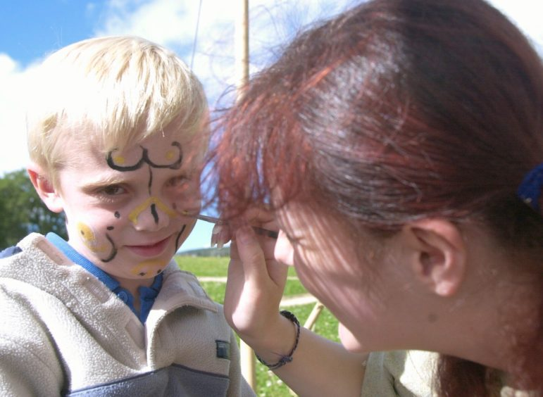 Gregor Brands 5 gets his face painted at the Iron Age Farm picture by Amanda Gordon