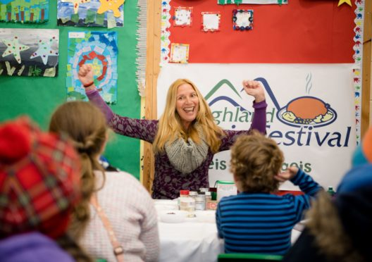 Author Mandy Elizabeth Rush reads her book Haggis history and facts to the young festival goers