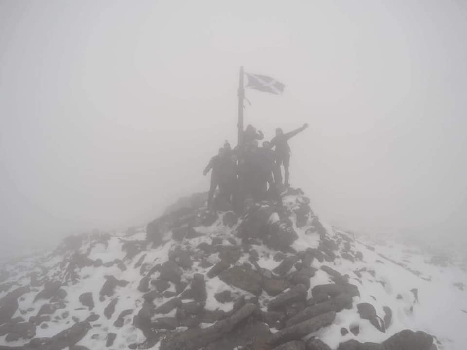 The team at the summit of Mount Keen on Sunday afternoon.