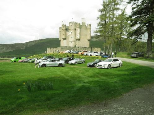 The convoy enjoys a break at Braemar Castle.