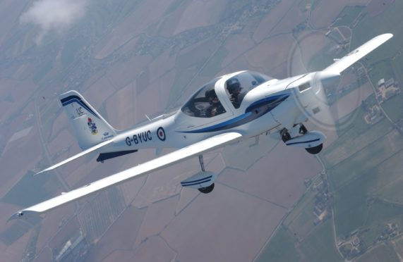 A Grob Tutor photographed over Lincolnshire, similar to the one to be used by the students.