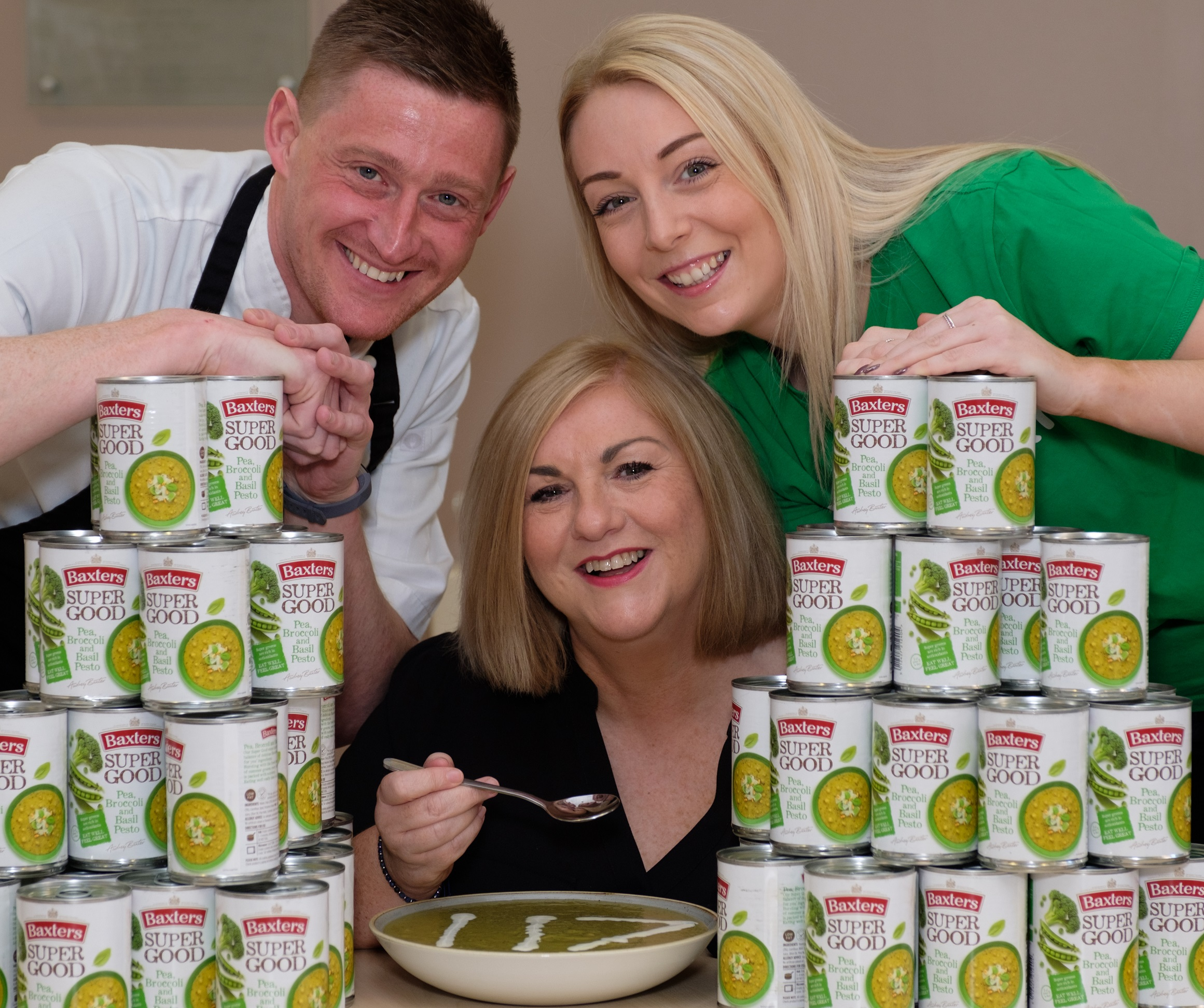 Baxters' Chief Innovation Chef Darren Sivewright with L-R Macmillan Information and Support Service Manager Elaine Gray and Macmillan Fundraising Manager Laura Foreman