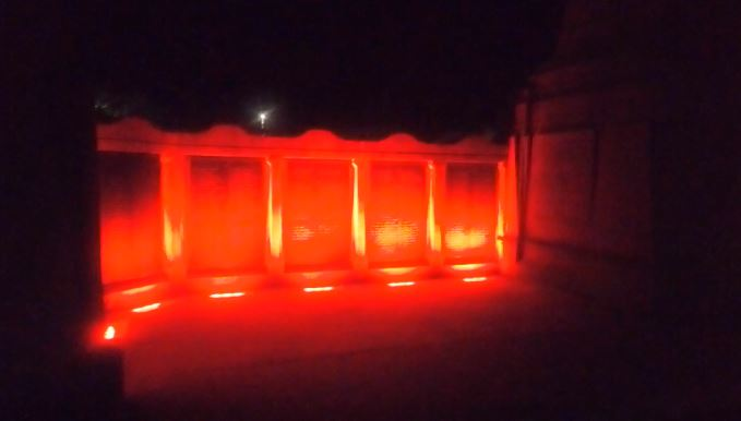 The war memorial in Inverness lit up red