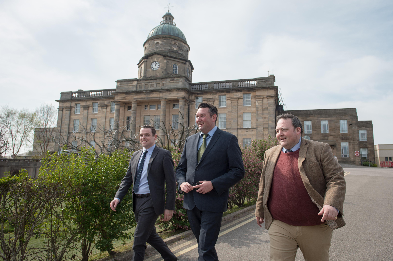 Moray MP Douglas Ross, Shadow Health Secretary Miles Briggs and Highlands and Islands MSP Jamie Halcro Johnston outside Dr Gray's Hospital.
