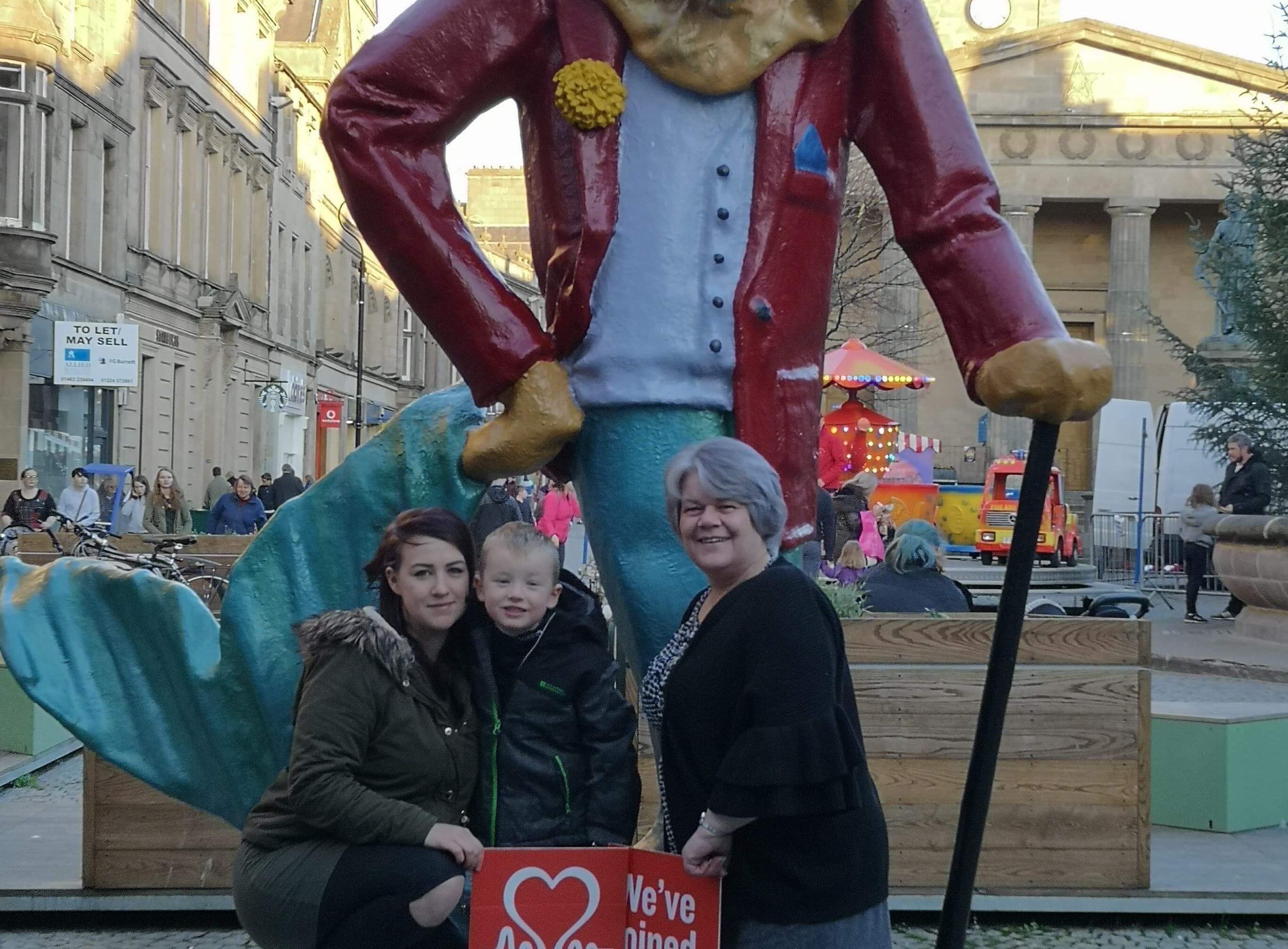Lauren O'Shane, her son Jordan and BHF Scotland shop manager Jo Hewitt in Elgin