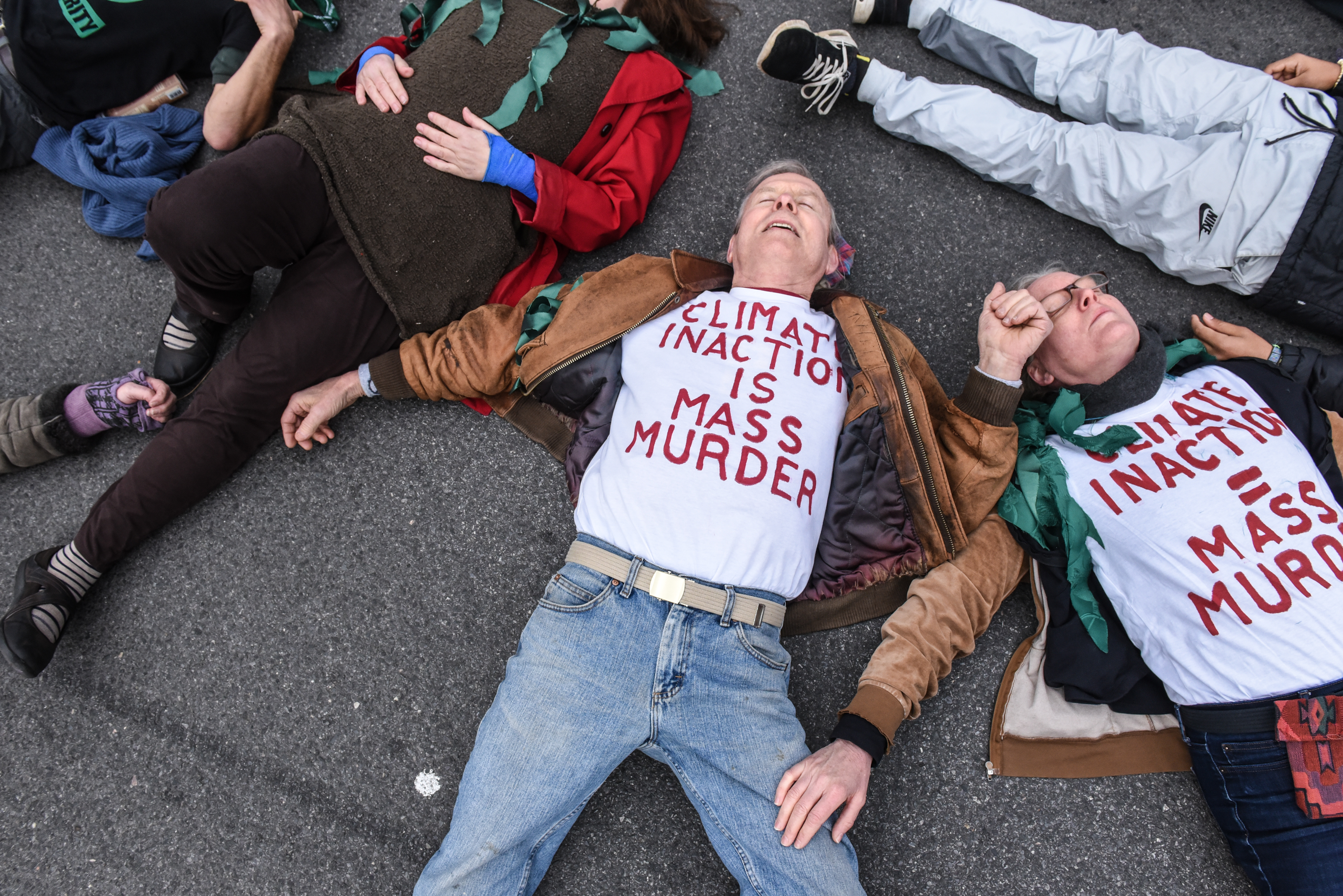 NEW YORK, NY - APRIL 17: People participate in a die-in direct action with a group protest organization called Extinction Rebellion on April 17, 2019 in New York City. The activists are demanding governments declare a climate emergency to combat pollution. (Photo by Stephanie Keith/Getty Images)