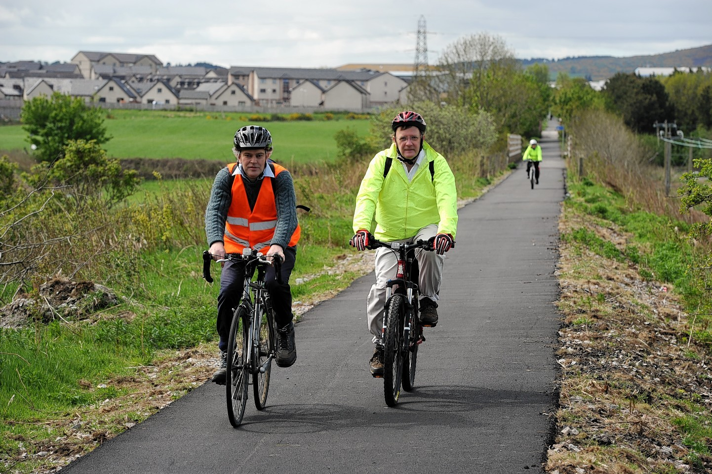 Councillors Martin Ford and Paul Johnston riding bikes on the Formartine and Buchan Way