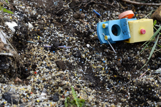 NORTH QUEENSFERRY, SCOTLAND - AUGUST 28: A child's plastic toy lies among some of the thousands of plastic pellets along the high water mark on the Firth of Forth, as a new map is published by a charity group showing the extent of marine litter and pollution around Scotland's coastline, on August 28, 2018 in North Queensferry, Scotland. The charity Sky Watch Civil Air Patrol have been surveying some of Scotland's coastline by air, using aerial photography to pinpoint pollution hotspots, and in collaboration with Moray Firth Partnership and the Marine Conservation Society have produced an interactive online map which it is hoped will help understand sources of pollution and facilitate clean-up efforts. (Photo by Ken Jack - Corbis/Corbis via Getty Images)
