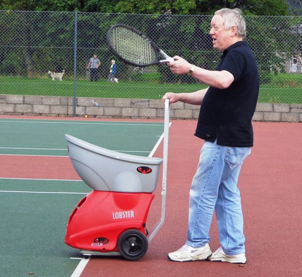 Hamish McBain received an award for his life-time work in tennis in Moray.