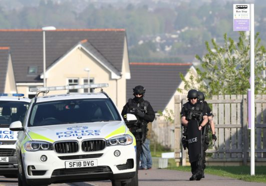 Armed Police were at a siege at a house in the Milton of Leys area of Inverness