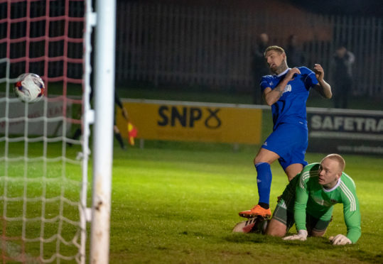 Cove's Martin Scott scores the only goal of the game. Picture: JasperImage.
