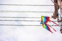 A kite stuck on a power line.
