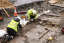 Archaeologists during the excavation works where remains of a 14th century castle have been uncovered