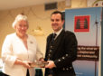 Fiona Macleod with winner of the annual competition, Finlay Johnston