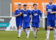 Cove celebrate Sam Burnett's goal. Picture by KATH FLANNERY
