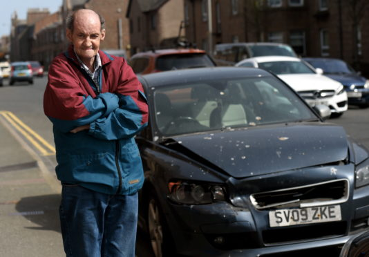 Eric Dean, 69, is unhappy with Aberdeenshire Council after he raised concerns about the broken down Volvo left near his home in King Street.